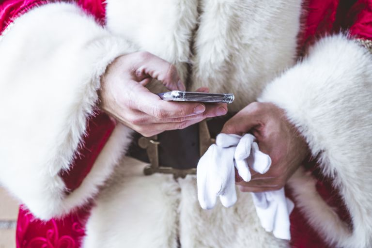 Santa Claus using smart phone