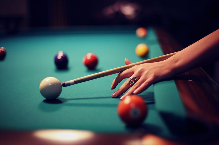 Hand of woman pool player