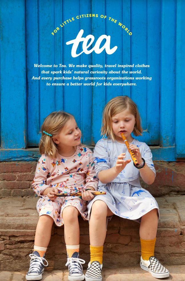 Two girls sitting on a stoop with flutes on the cover of Tea catalog