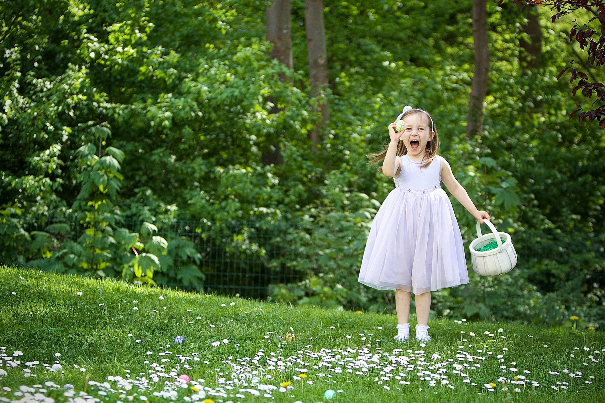 A girl finding an Easter egg