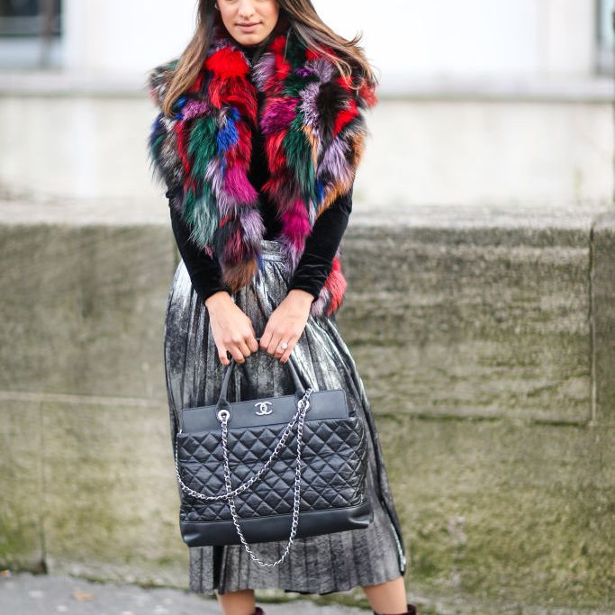 29e8b51d413b Fashion woman in colorful faux fur coat and pleated skirt