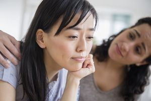 Woman comforting sad friend