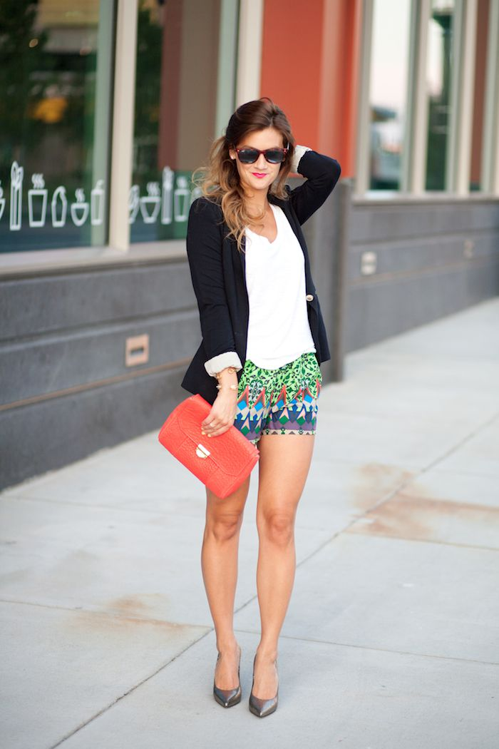 Woman in printed shorts and blazer