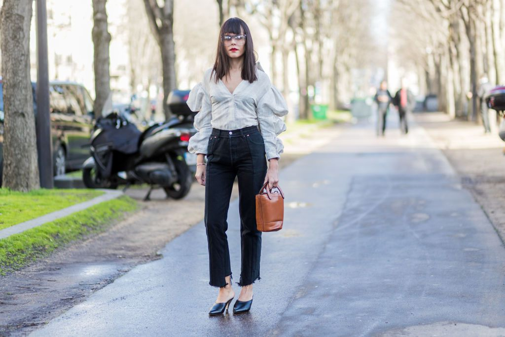 Street style ruffled blouse and straight leg frayed jeans