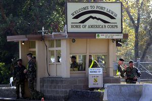 TACOMA, WA - OCTOBER 24: Soldiers stand guard at the entrance to Fort Lewis October 24, 2002 in Tacoma, Washington.