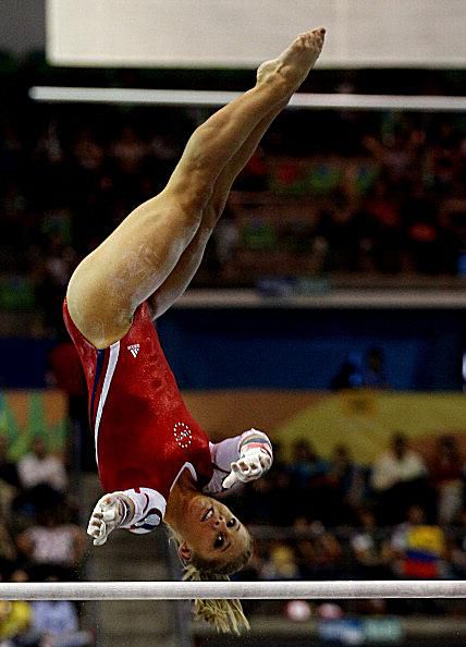 Gymnast Shawn Johnson does a Gienger release move on bars at the 2011 Pan American Games