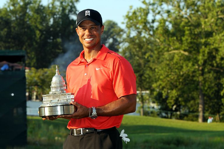 Tiger Woods with the Quicken Loans National trophy