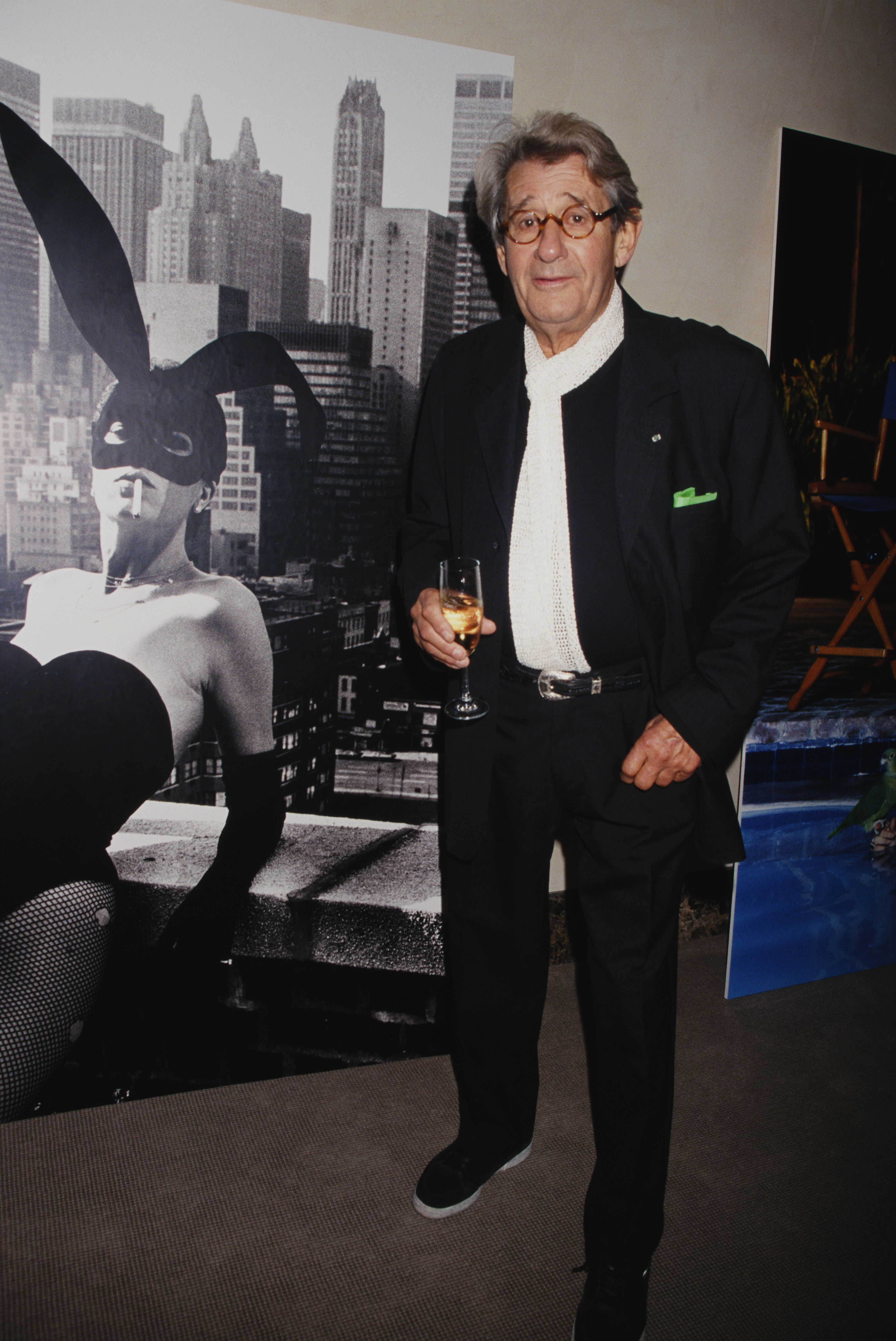 German-Australian photographer Helmut Newton (1920 - 2004) at Christie's in front of his photograph of Elsa Peretti, New York City, USA, 1998.