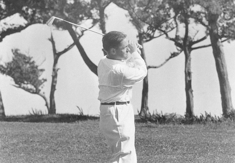 Bobby Jones playing golf in Bermuda, hitting a shot with a mashie.