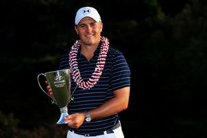 Jordan Spieth celebrates with the trophy after winning the final round of the Hyundai Tournament of Champions at the Plantation Course at Kapalua Golf Club on January 10, 2016