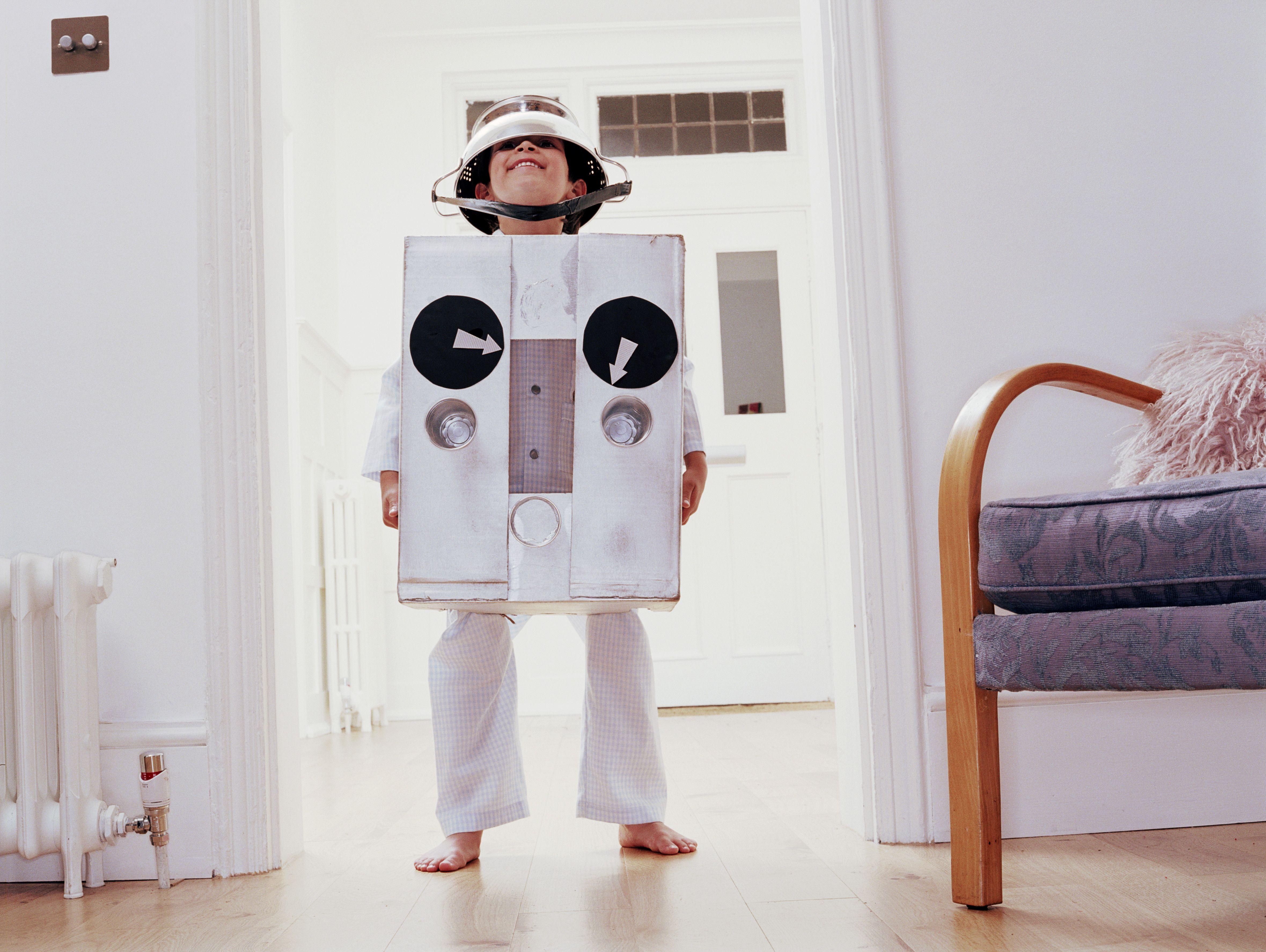 Boy (6-8) wearing robot costume