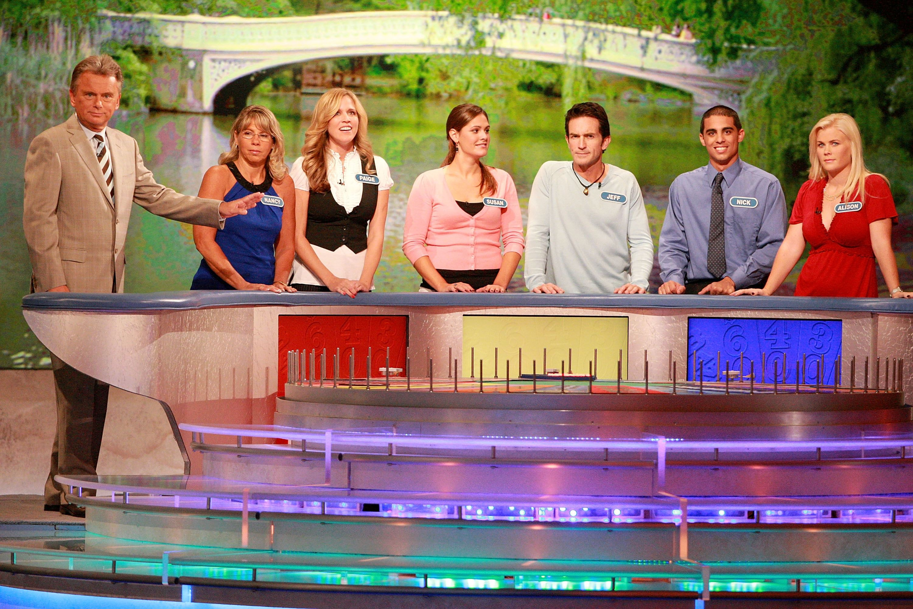 (L-R) Host Pat Sajak greets Nancy Kaufman, actress Paige Hemmis, Susan Moran, actor Jeff Probst, Nick Giovine and actress Alison Sweeney during a taping of 'Wheel Of Fortune Celebrity Week' celebrating the television game show's 25th anniversary at Radio City Music Hall on September 29, 2007 in New York City.