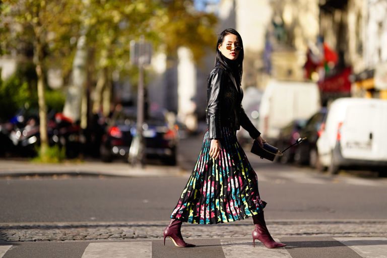 Street style woman in floral skirt and leather jacket