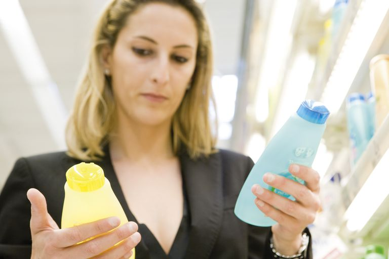 Woman comparing body care products