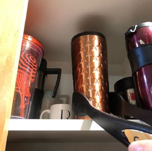 using tongs to get cup from high shelf