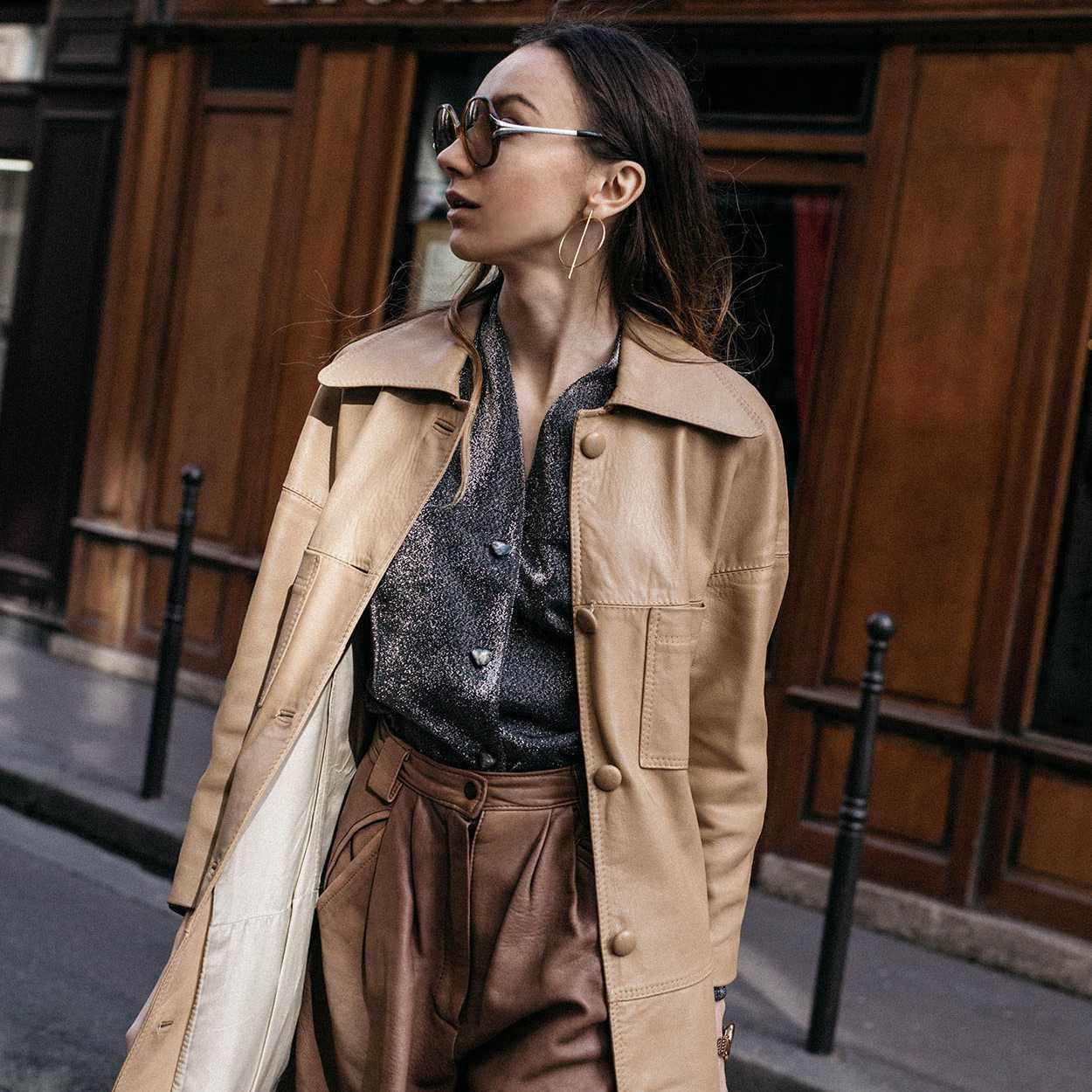 Woman wearing a beige leather trench coat