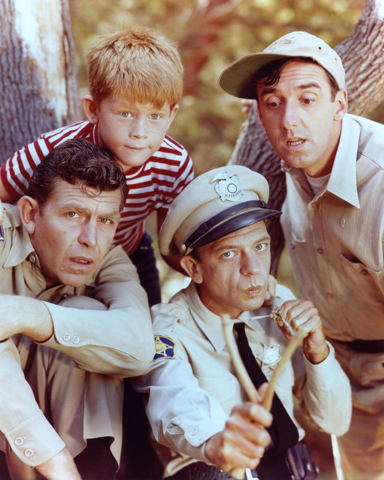 Andy Griffith as Sheriff Andy Taylor, Jim Nabors as Gomer Pyle, Ron Howard as Opie Taylor and Don Knotts as Deputy Barney Fife in 'The Andy Griffith Show', circa 1963. (Photo by Silver Screen Collection/Getty Images)