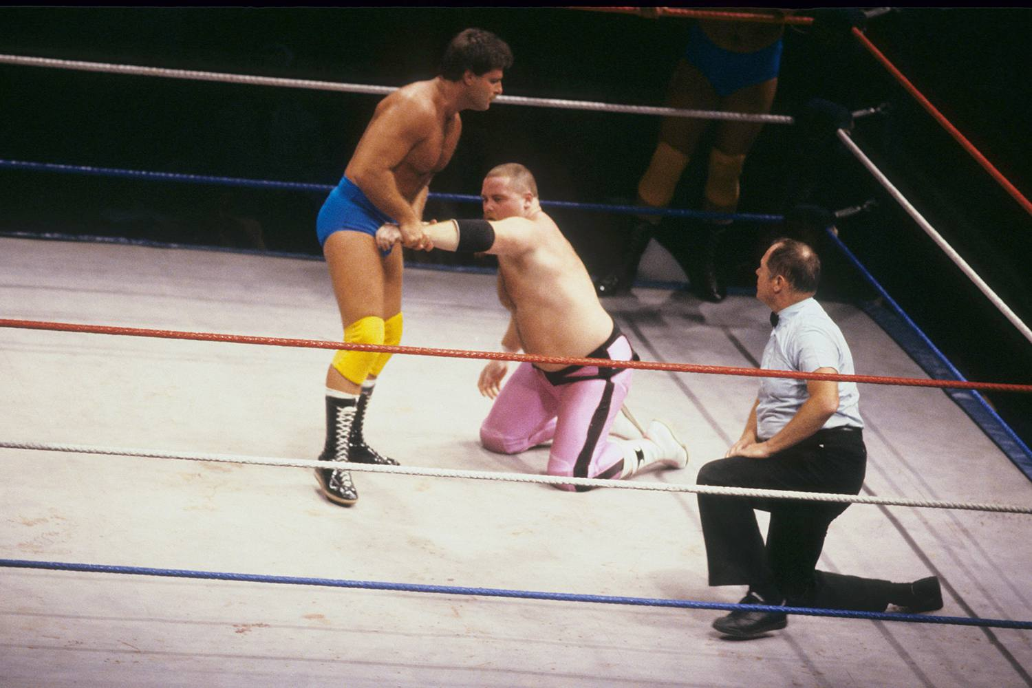 WWF Wrestler Raymond Rougeau puts the hold on Jim 'The Anvil' Neidhart during a WWF match on July 17 1987 at Nassau Coliseum in New York, New York.