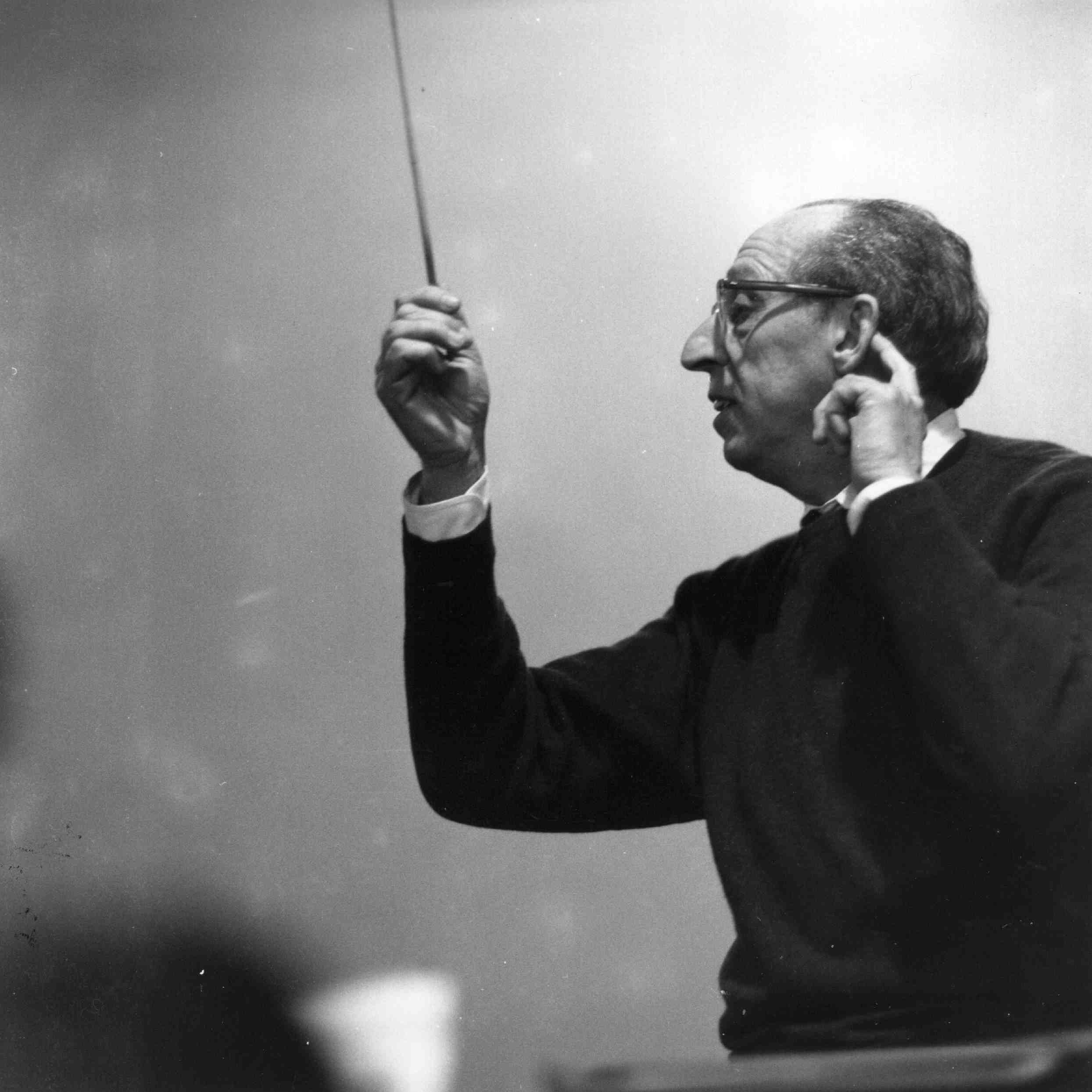 Aaron Copland conducts an orchestra