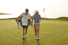 A looper, or caddie, and the golfer whose bag he carries