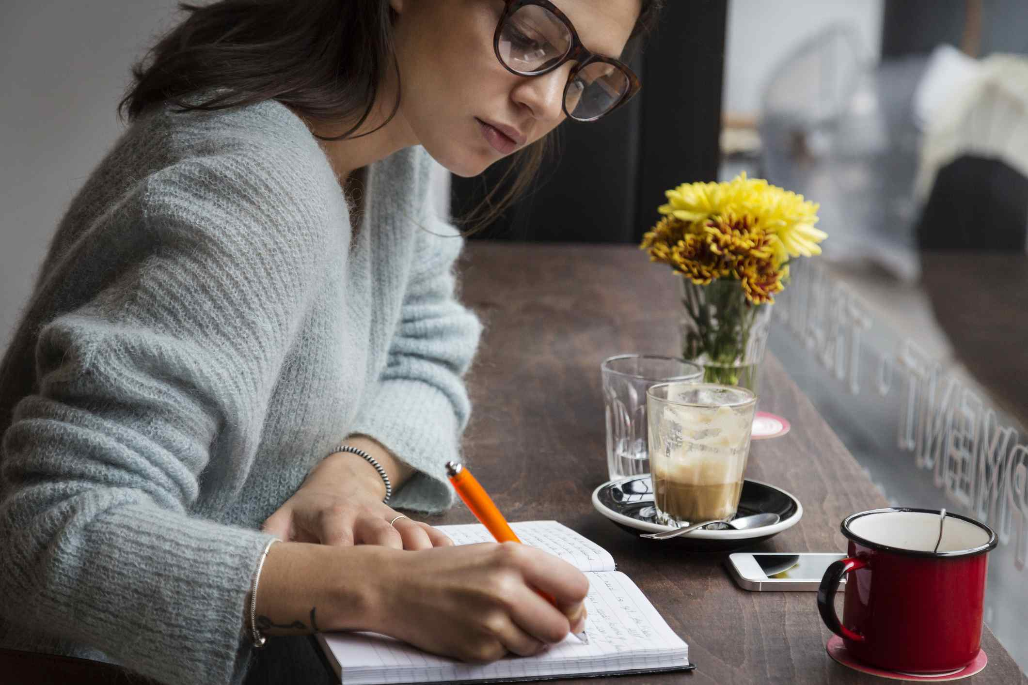 Woman doing writing exercises in a journal