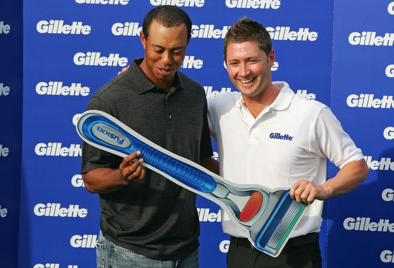 Tiger Woods with a giant Gillette razor