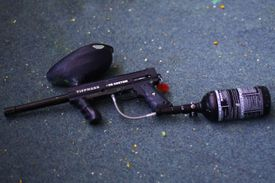 A paintball gun with a CO2 tank attached to it.