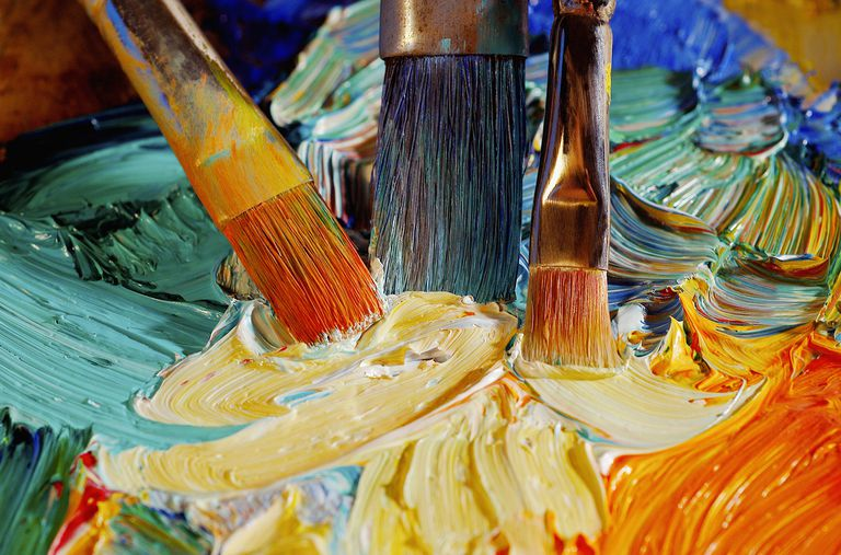 Paintbrushes Mixing Paint on a Palette