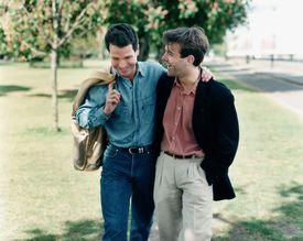 Gay couple walking in park