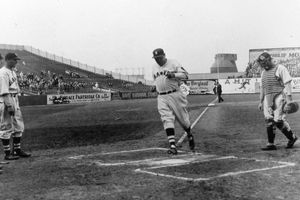 Babe Ruth of the Boston Braves crosses home plate