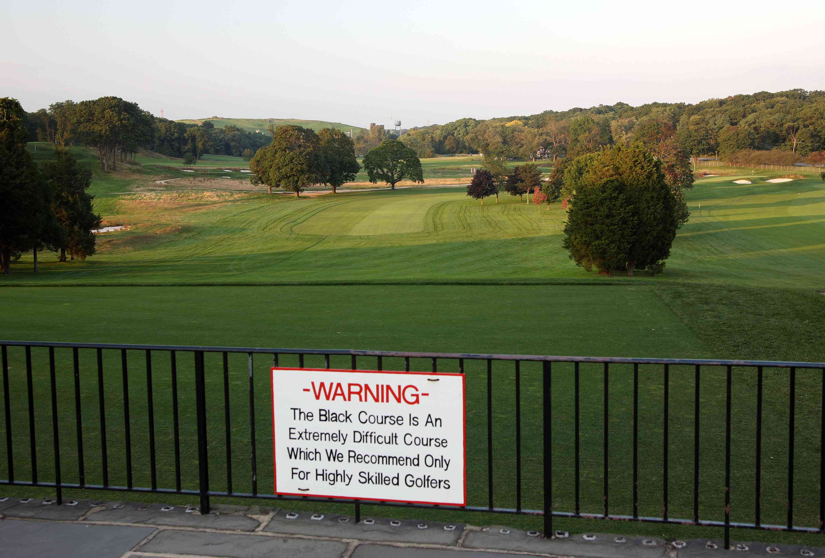 A warning sign welcomes golfers who dare try the Black Course at Bethpage State Park