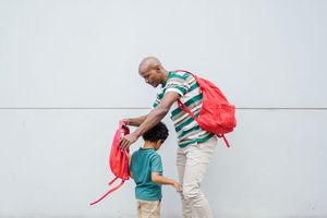 father and son with backpacks