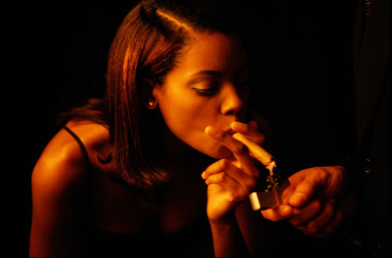 A woman smoking a cigar