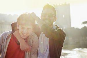 Friends joking outdoor at sunset