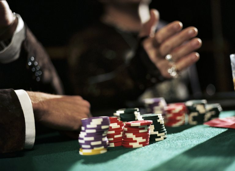 Chips on table in front of Poker player