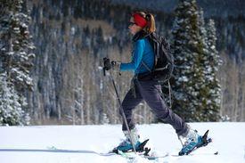 Woman backcountry randonee skiing on Rabbit Ears Pass in Colorado