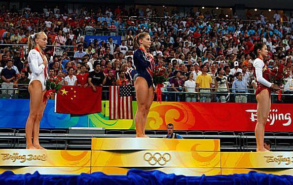 A gymnastics photo of Shawn Johnson, Nastia Liukin and Cheng Fei on the podium at the 2008 Olympics