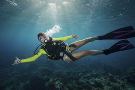 Woman scuba diving in tropical water