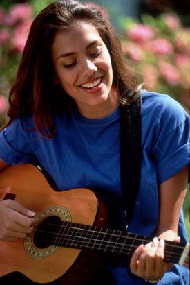 Teen Girl Playing Guitar