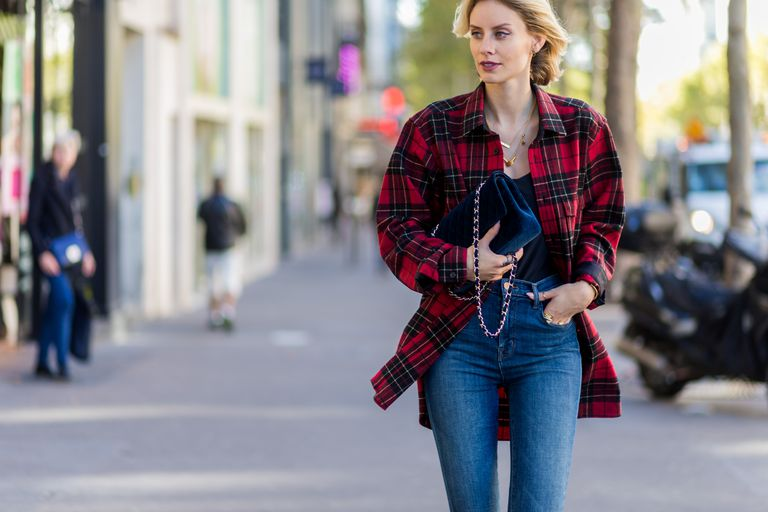 Street style woman in jeans and plaid shirt
