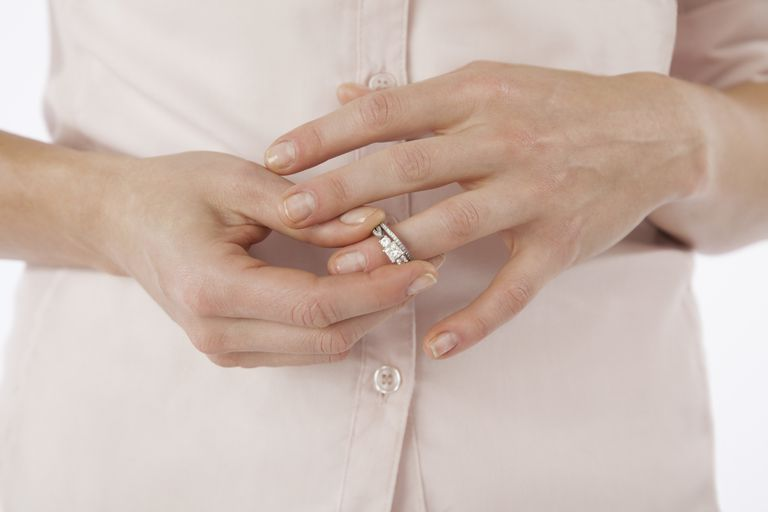 woman removing wedding rings