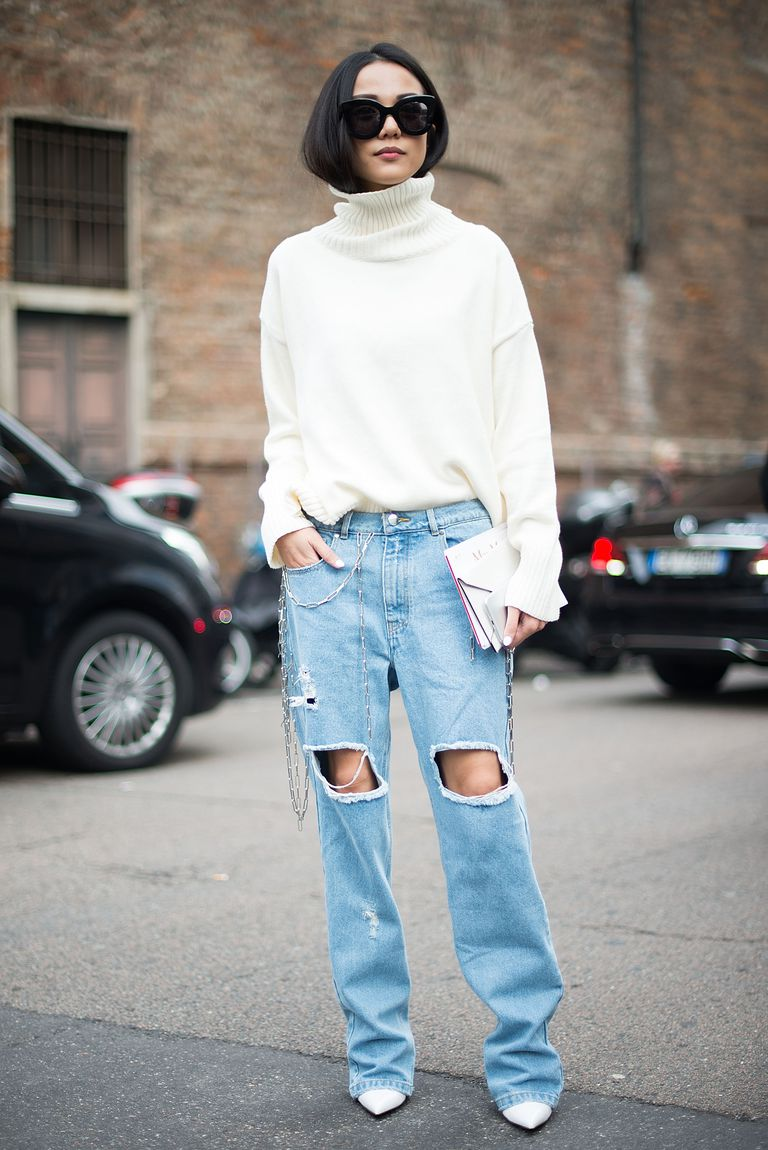 Ripped jeans and sweater street style photo