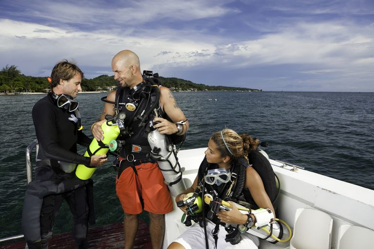 Couple Preparing for a Deep Sea SCUBA Dive
