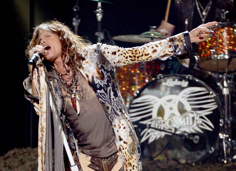 Steven Tyler singing on stage.