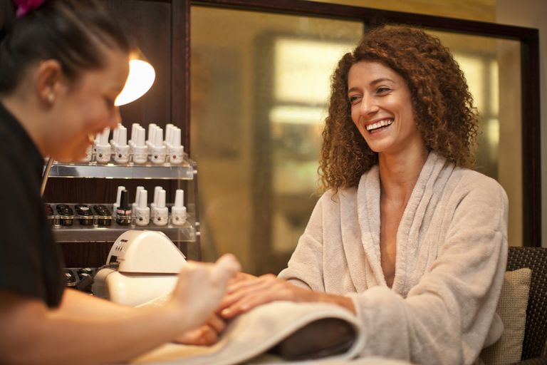 A young woman get a manicure at a spa.