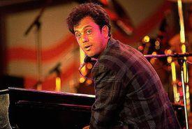 Billy Joel at a piano
