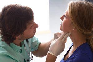 Doctor examining an patient's throat