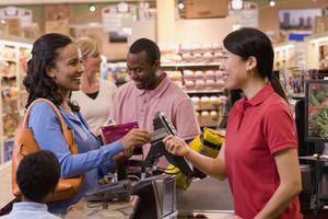 Customer Handing Store Card to Cashier