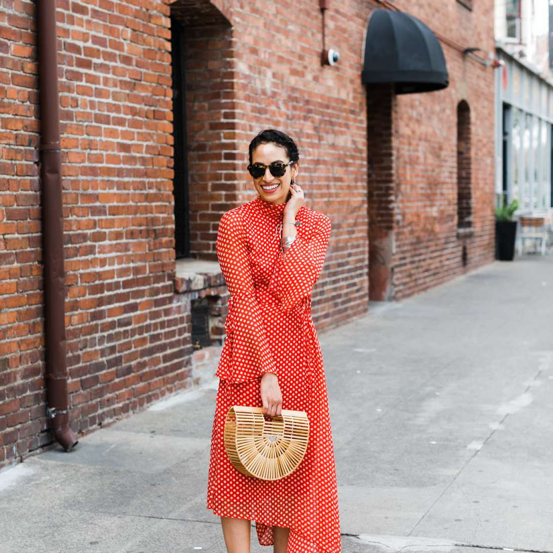 Woman in red polka dot maxi dress