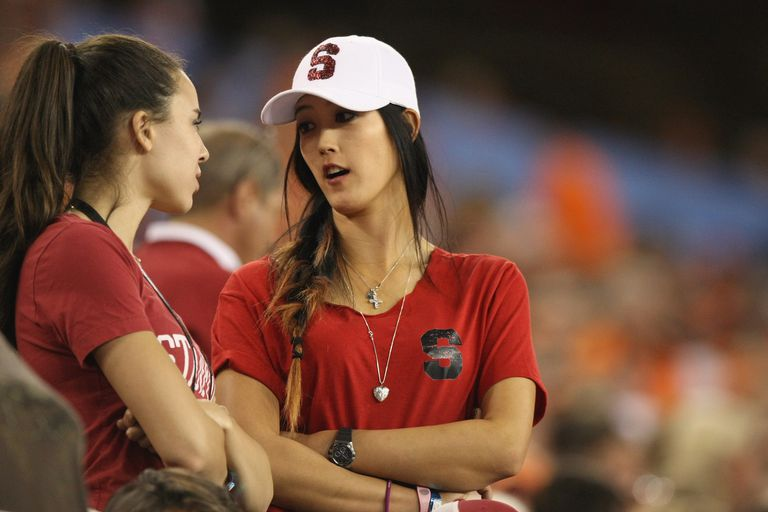 Pro golfer Michelle Wie supports the Stanford Cardinal as they play against the Oklahoma State Cowboys during the Tostitos Fiesta Bowl on January 2, 2012